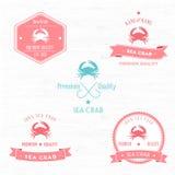 Uppsättning för emblem för tappninghavskrabba Royaltyfri Bild