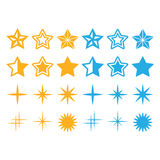 Uppsättning för gula stjärnor och för blåa stjärnor symbols Arkivfoton