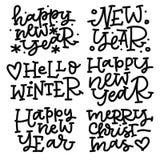Uppsättning för julhandbokstäver Det lyckliga nya året hälsning övervintrar, glad jul Royaltyfria Bilder
