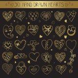 Uppsättning för klotter för hjärtahandteckning Guld- garnering royaltyfri illustrationer