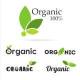 uppsättning för 100% organisk produktlogo Naturliga matetiketter Ny lantgård s Royaltyfri Foto