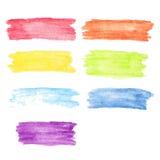 Uppsättning för regnbågevattenfärgfläckar Arkivfoto