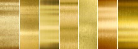 Uppsättning för sju olik borstad guld- metalltexturer royaltyfri foto
