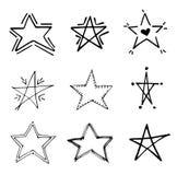 Uppsättning för vektor för stjärnaklottersvart geometrisk Gullig hand drog stjärnor på vit bakgrund Vektorillustration för trycke Royaltyfria Foton