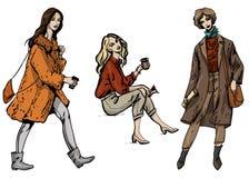 Uppsättning för vektormodeillustration av tre stilfulla flickor i gatamodestil i gråa bruna och orange färger som isoleras på vit royaltyfri illustrationer