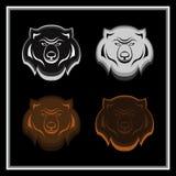 Uppsättningen av björnen heads emblem Arkivbild