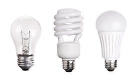 Uppsättningen av den ljusa kulan LEDDE CFL som var fluorescerande på vit Arkivfoto