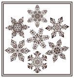Uppsättningen av den svarta eleganta geometriska snöflingan för vinter 7 formar Royaltyfri Fotografi