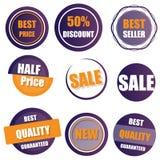 Uppsättningen av försäljningen, köper nu, det nya halva prisbanret i guling och purpl Arkivfoton