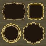 Uppsättningen av guld 4 blänker ramar Fotografering för Bildbyråer