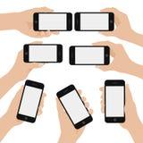 Uppsättningen av handinnehav ilar telefonen vektor illustrationer