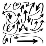 Uppsättningen av handteckningen isolerade pilsamlingen på den vita backgrouen Arkivbilder