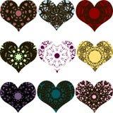 Uppsättningen av hjärta formade dekorativa beståndsdelar med prydnader Royaltyfri Fotografi