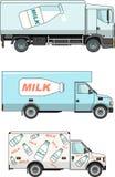 Uppsättningen av mjölkar bilar på vit bakgrund i a Arkivfoton
