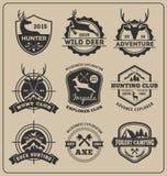 Uppsättningen av monokrom djur jakt och affärsföretaget förser med märke logo stock illustrationer