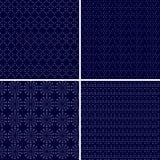Uppsättningen av 4 prack dekorativt mörker - blåa sömlösa modeller Arkivbilder