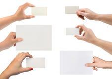 Uppsättningen av räcker med det pappers- kortet arkivbild