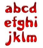 Uppsättningen av rött stelnar och små bokstäver för karamellalfabet som isoleras på wh Royaltyfri Fotografi