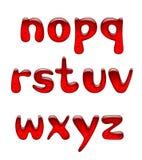 Uppsättningen av rött stelnar och små bokstäver för karamellalfabet som isoleras på wh Royaltyfria Foton