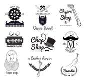 Uppsättningen av retro mäns barberare shoppar logo och planlägger beståndsdelen Royaltyfria Foton