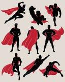 Uppsättningen av superheroen i olika 9 poserar Arkivfoto