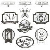 Uppsättningen av tappningbarberaren shoppar logoen, etiketter, emblem Arkivbilder