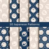 Uppsättningen av tio sömlösa vektorjapanmodeller med lotos blommar planlägg för inre, trycket, textilen, räkningar royaltyfri illustrationer
