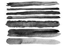 Uppsättningen av vattenfärgen borstar slår isolerat arkivbilder