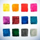 Uppsättningen av vattenfärgmålarfärg kvadrerar i vibrerande färger Arkivfoto