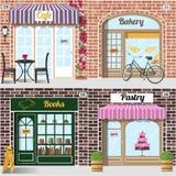 Uppsättningen av vektorn specificerade designbagerit, kafét, bokhandeln och bakelse shoppar royaltyfria foton