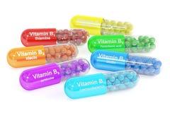Uppsättningen av vitaminet capsules B1, B2, B3, B5, B6, B7, B12 framförande 3d Royaltyfria Foton