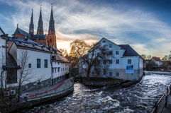 Uppsala from the bridge. View of the cathedral, the river Fyris and the Uppland museum at sunset in Uppsala, Sweden royalty free stock image