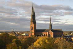Uppsala cathedral. In Sweden and autumn trees Royalty Free Stock Photography