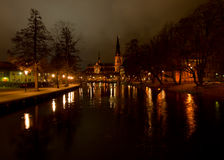 Uppsala by night. A scenic view of Uppsala by night with the Cathedral and Fyris river in focus royalty free stock image