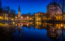 Uppsala by night. Night view of the cathedral, the river Fyris and part of the skyline in Uppsala, Sweden stock photo
