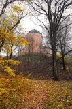 Uppsala 16th century castle in autumn. Autumn by the castle of Uppsala, Sweden. Fall trees with sparkling leaves and a small path leads up to this beautiful royalty free stock photo