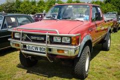 Uppsamling Datsun/Nissan Y720 konung Cab royaltyfria bilder