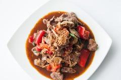 Thailändsk uppståndelse stekt nötköttostronsås. royaltyfri bild