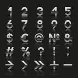 Uppsättning av dekorativa silvernummer och symboler Arkivfoto