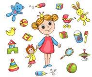 Uppsättning av flickas leksaker Arkivbild