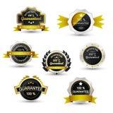 Uppsättning av försäljningsetiketter, det guld- garantiemblemet, emblemet eller symbolet Royaltyfri Fotografi