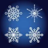 Uppsättning av fyra eleganta snöflingor, dekorativa designbeståndsdelar Royaltyfria Foton