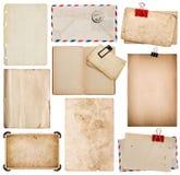 Uppsättning av gamla pappersark, bok, kuvert, fotoram med hörnet Arkivfoton