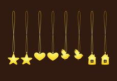 Uppsättning av guld- hängear Arkivfoto