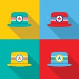 Uppsättning av hattar på färgrik bakgrund Arkivbild