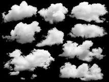 Uppsättning av isolerade moln över svart Royaltyfri Bild