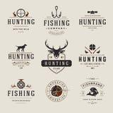 Uppsättning av jakt- och fiskeetiketter, emblem, logoer Arkivfoto