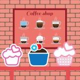 Uppsättning av kakor och coffee shopobjekt med americano Royaltyfri Fotografi