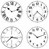 Uppsättning av olika klockaframsidor Arkivbild