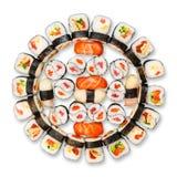 Uppsättning av sushi, maki, gunkan och rullar som isoleras på vit Arkivbilder